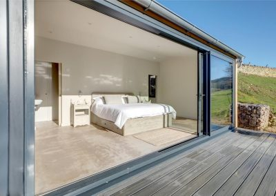 Bi-fold doors open up the bedroom to the decking